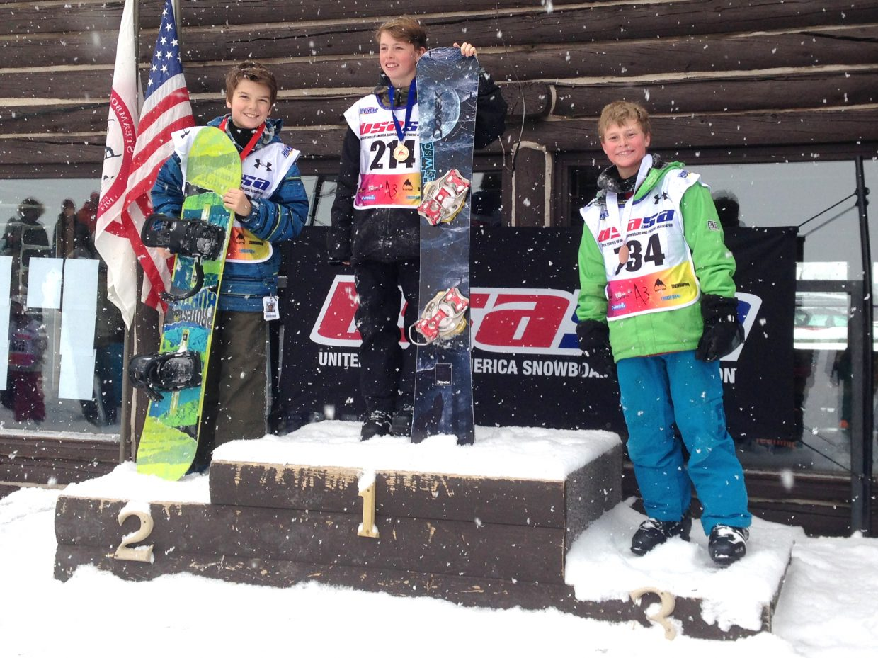 Steamboat Springs riders Jacy Werner, left and second place, Winston Vaughan, center, and Cooper Scheel, make up the podium for a breaker boys snowboard race Sunday at Howelsen Hill in Steamboat Springs.