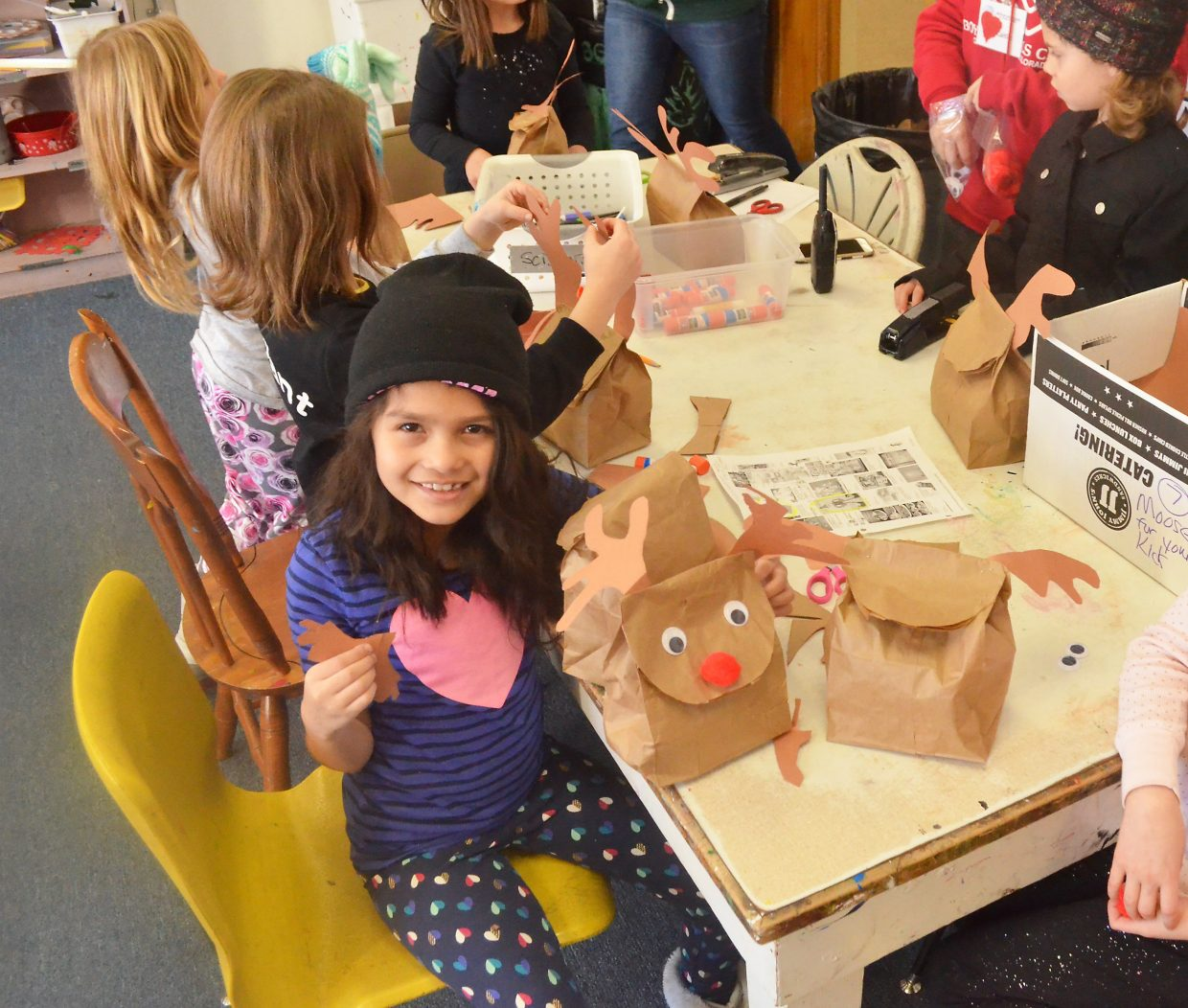 Emily Lopez, 8, puts the finishing touches on a reindeer made from a lunch bag Thursday before hurrying off to play dodge ball at the Boys and Girls Club of Steamboat Springs.