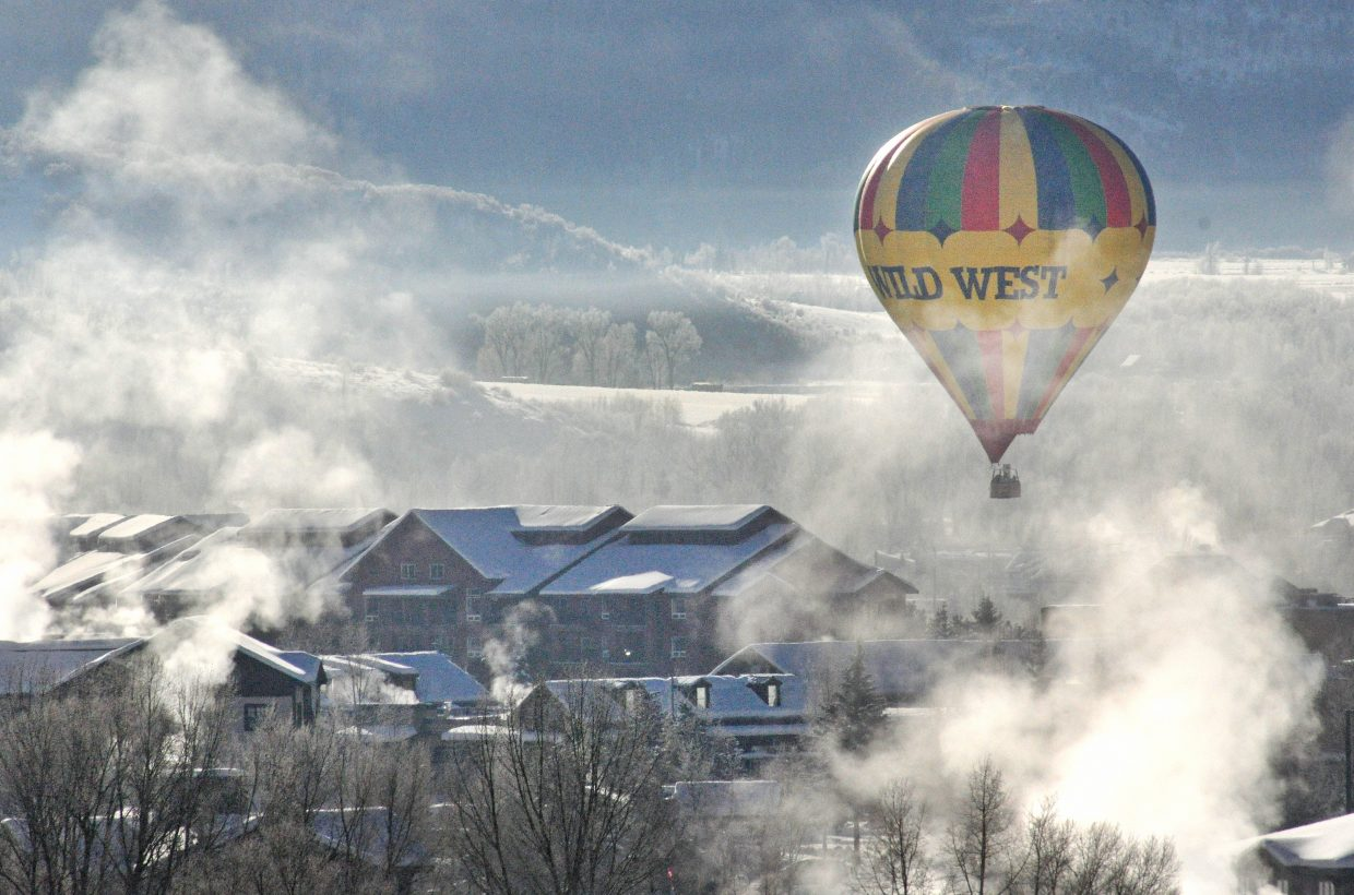 A hot air balloon floats above Steamboat Springs Thursday on a frosty morning. There are slight chances of more snow in Steamboat's weekend forecast.