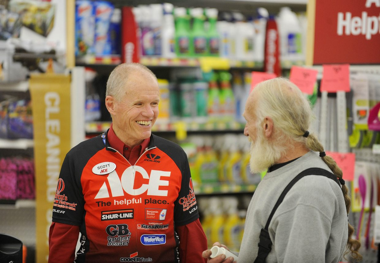 Steamboat Springs Ace Hardware Manager Scott Schlapkohl visits with customer Dale Cross on Tuesday during Schlapkohl's retirement party.