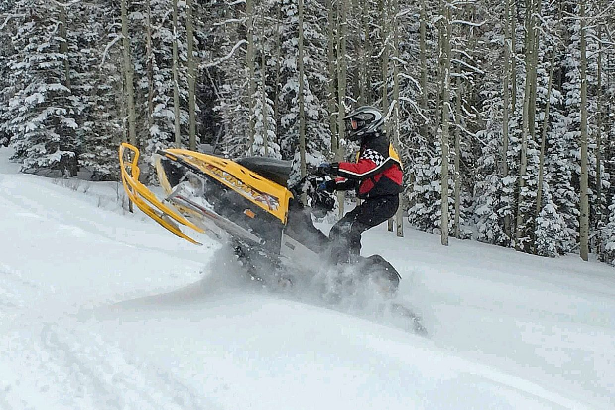 Craig resident Gary Cole takes off on his snowmobile.