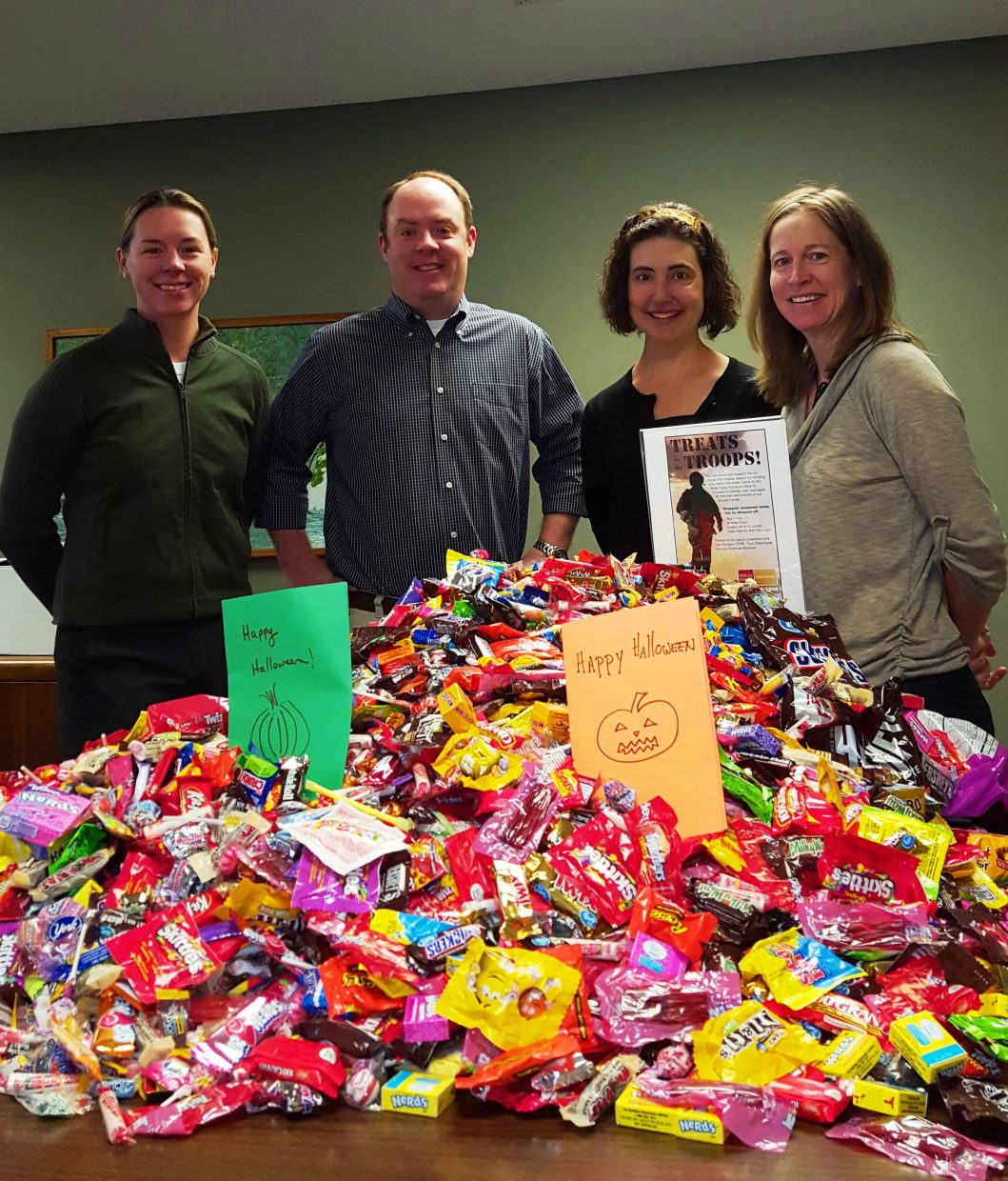 Wells Fargo Financial Advisors in Steamboat Springs hosted Treats for the Troops candy collections. Thanks to the community's generosity, 135 pounds of candy were shipped to soldiers for the holidays. Pictured with the donated candy, from left, are Laura Cusenbary, Dan Sturges, Jennifer Stoddard and Christina Freeman of Wells Fargo Advisors.