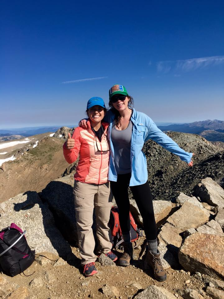 Ashley Stewart and Audrey Dwyer stand at the summit of Mount Massive at 14,428 feet.