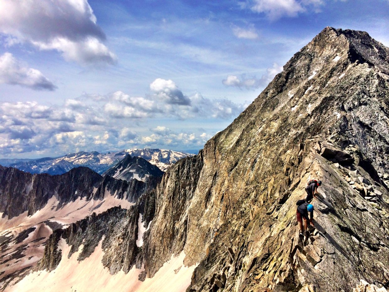 Members of the PedAll the Peaks expedition descend the knife ridge this week on Capitol Peak, one of the 14,000-foot peeks near Aspen.