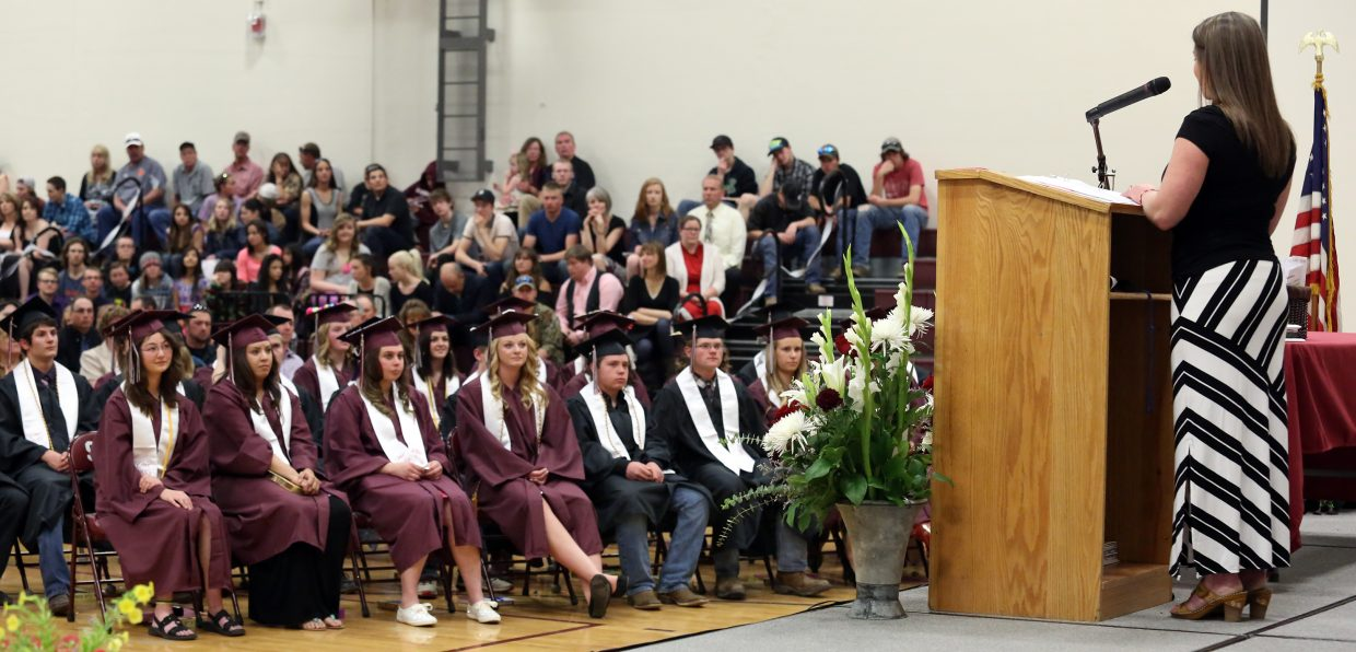The 2015 Soroco High School graduating class listens to Julie Hoff, right, give her commencement speech during the Soroco High School graduation on Saturday, May 23, 2015, in Oak Creek.