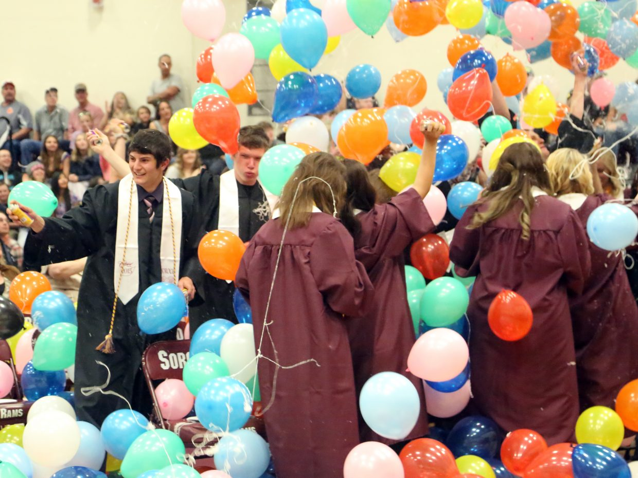 Balloons fall from the ceiling of the gymnasium at the conclusion of the Soroco High School graduation on Saturday, May 23, 2015, in Oak Creek.