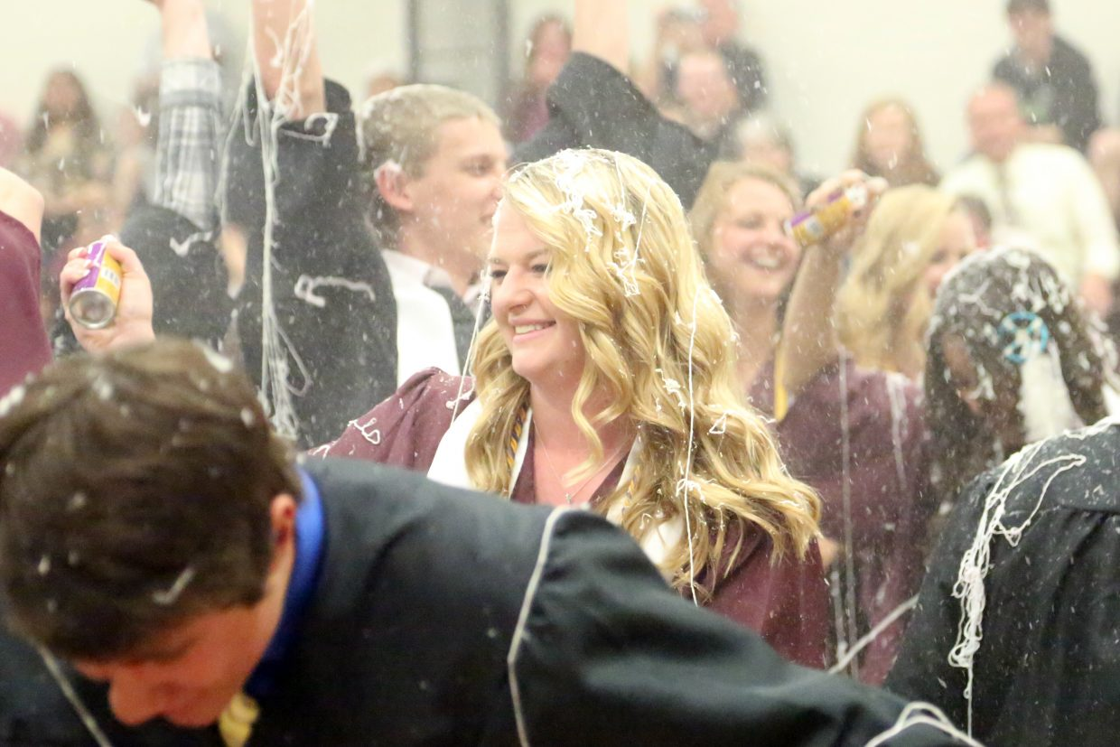 Nicole Williams celebrates with her 2015 Soroco High School graduates as they spray each other with silly string following the closing remarks on Saturday, May 23, 2015, in Oak Creek.