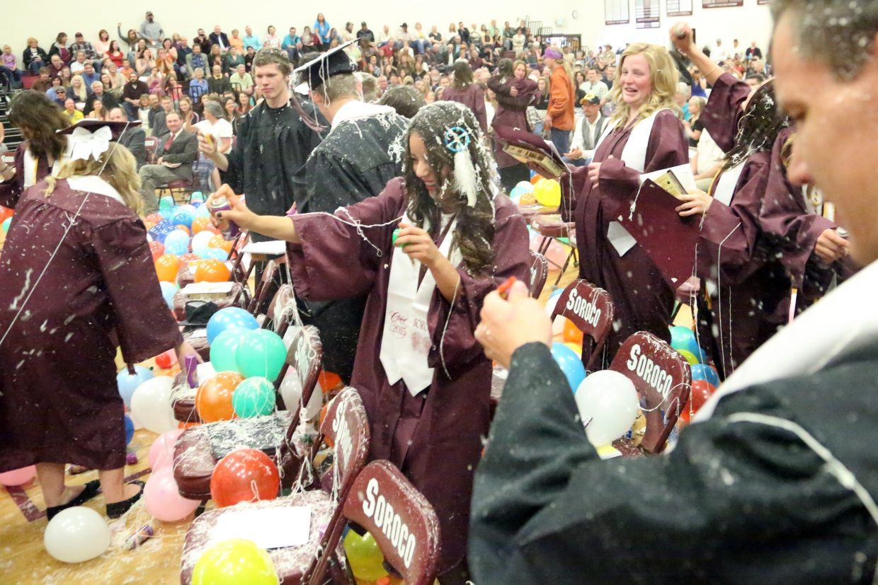 The 2015 Soroco High School graduating class sprays each other with silly string following the closing remarks of their graduation on Saturday in Oak Creek.