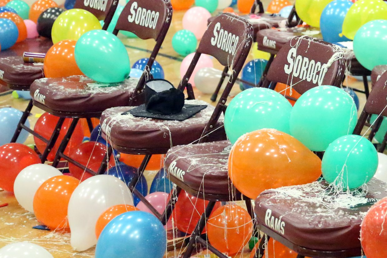 The gymnasium chairs are littered with silly string and balloons following the Soroco High School graduation on Saturday in Oak Creek.
