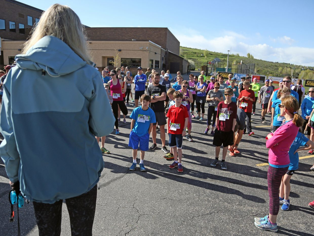 Race director Pam Wooster, left, talks to runners before the start of the Steamboat Springs Running Series Spirit Challenge on Saturday, May 23, 2015, near Steamboat Springs Middle School.