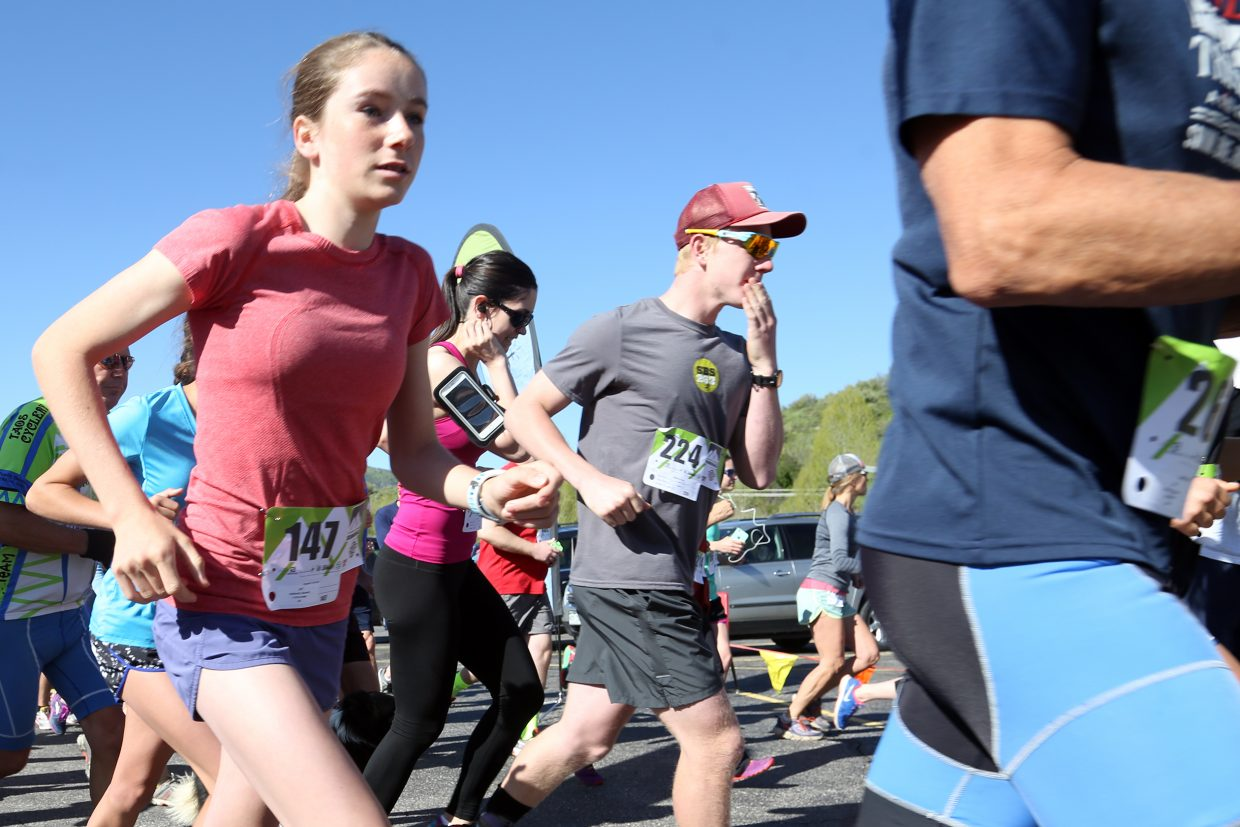 Runners cross the starting line in the Steamboat Springs Running Series Spirit Challenge on Saturday, May 23, 2015, near Steamboat Springs Middle School.