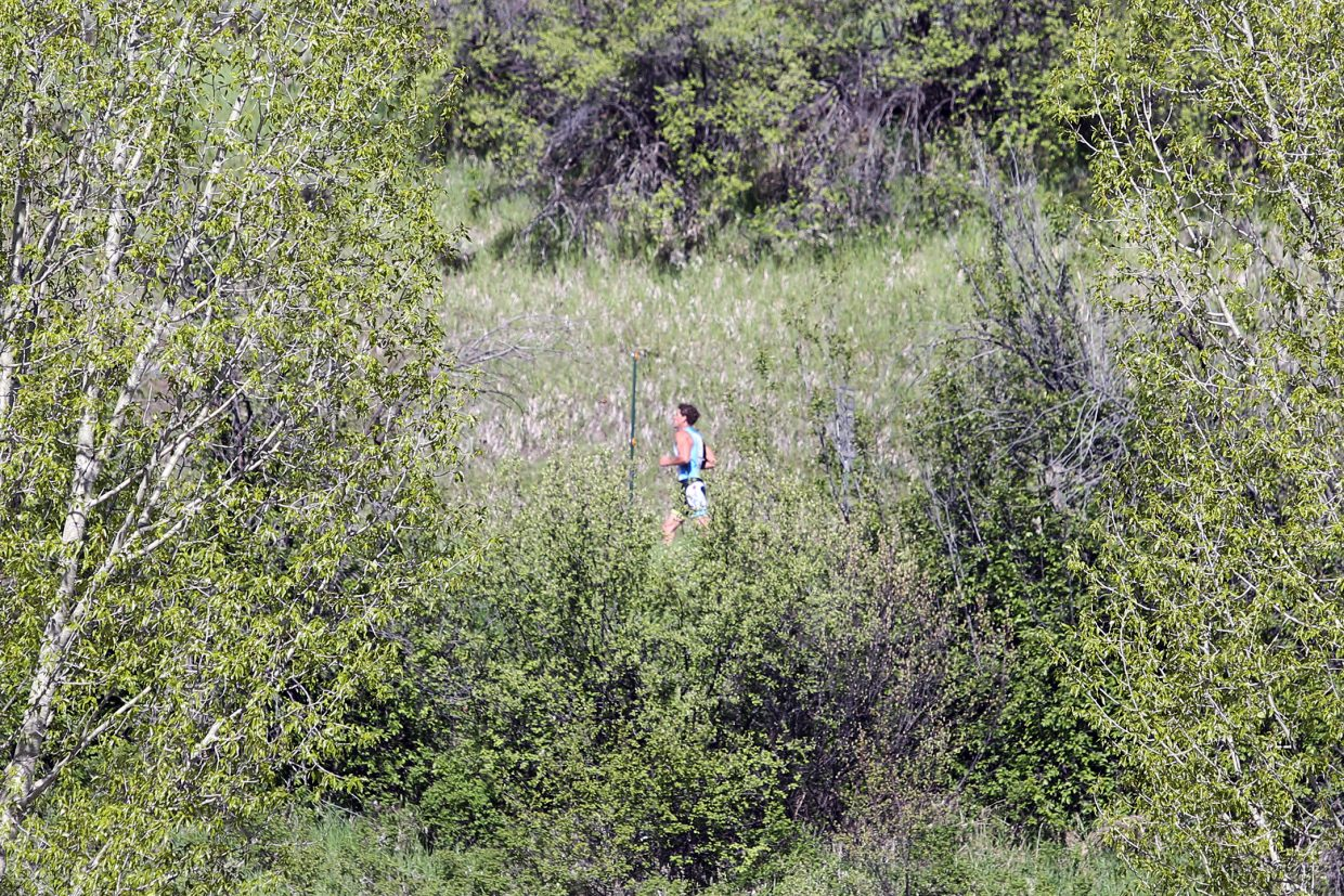 A runner competes in the Steamboat Springs Running Series Spirit Challenge on Saturday, May 23, 2015, near Steamboat Springs Middle School.