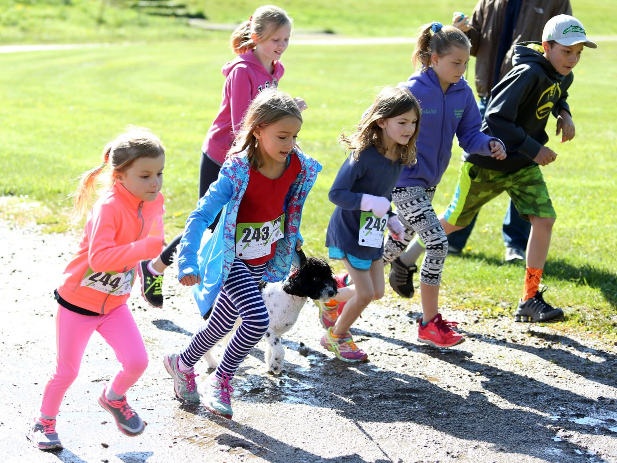 Children compete in the kids' 800-meter fun run during the Steamboat Springs Running Series Spirit Challenge on Saturday, May 23, 2015, at Steamboat Springs Middle School.