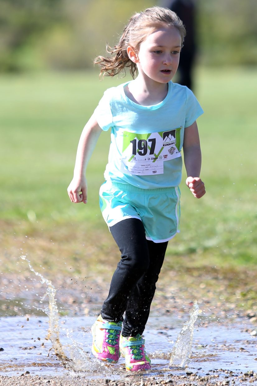 Steamboat Springs' Georgia Bishop, 4, competes in the kids' 800-meter fun run during the Steamboat Springs Running Series Spirit Challenge on Saturday, May 23, 2015, at Steamboat Springs Middle School.