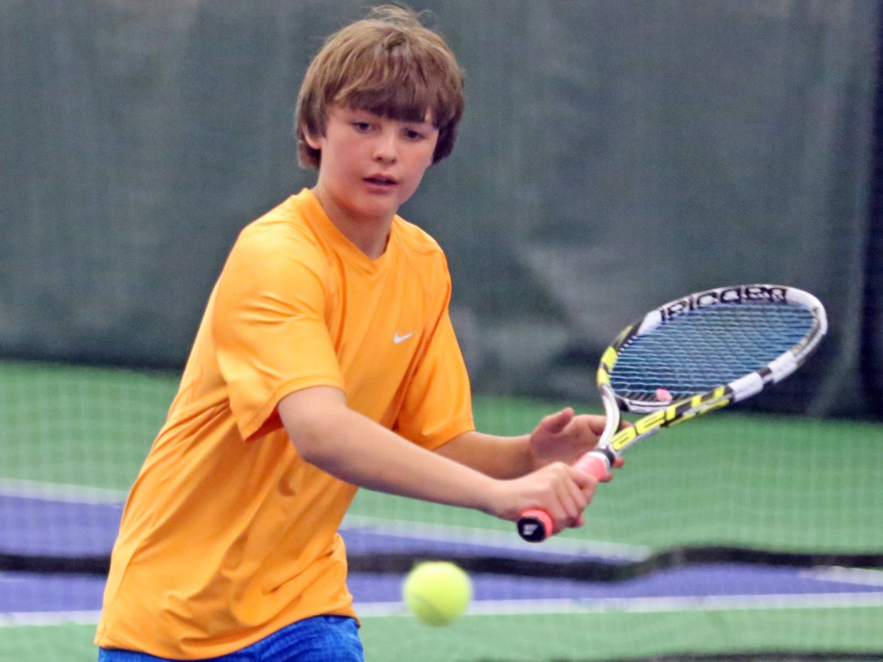 Steamboat Springs' Andy Schuiling, 11, practices between matches on Sunday at the Tennis Center at Steamboat Springs. He is taking part in the United States Tennis Association (Intermountain Section) 12 and under Memorial Day Tennis Championships, a three-day event that concludes Monday and hosts some of the region's best young tennis players.