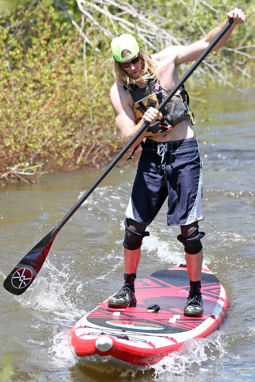 Jeremiah Williams, of Vail, competes in the first SUP Cup event on Saturday near Fetcher Pond. Williams tied for first in the paddeboarding series, which was part of the 35th annual Yampa River Festival in Steamboat Springs.