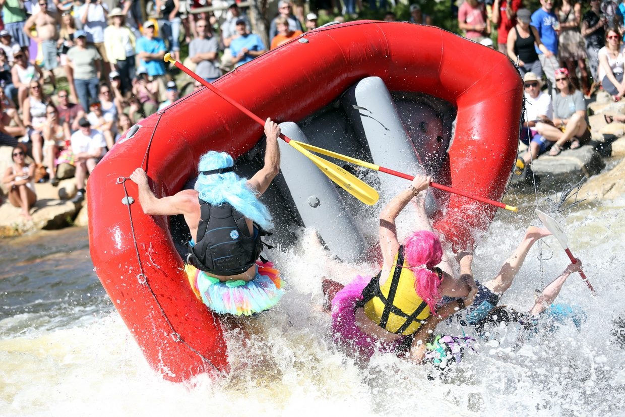 Rafters go overboard as they try to tackle Charlie's Hole during the 35th annual Yampa River Festival on Saturday in Steamboat Springs.