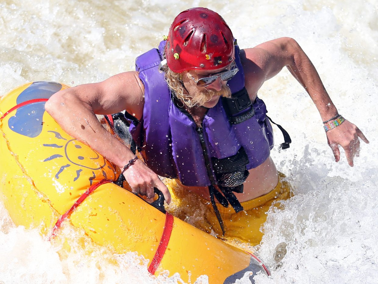 Part-time Steamboat Springs resident Josh Burton competes in the Tube Rodeo event on Saturday at Charlie's Hole in Steamboat, part of the 35th annual Yampa River Festival. Burton won the event for a second time, the first coming in 2009.
