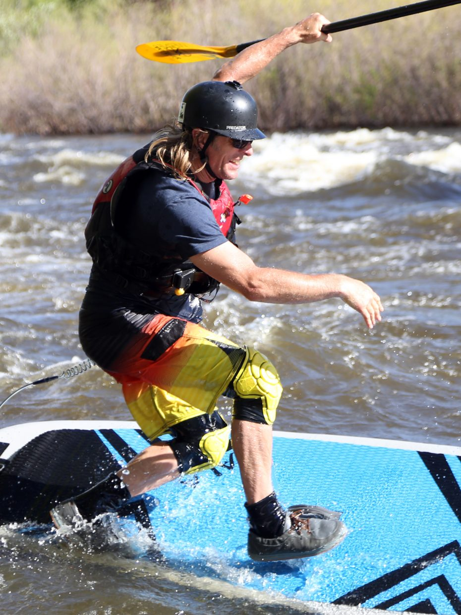 Richard Harrison struggles to maintain his balance during a paddleboarding event Saturday at the 2015 Yampa River Festival in Steamboat Springs.
