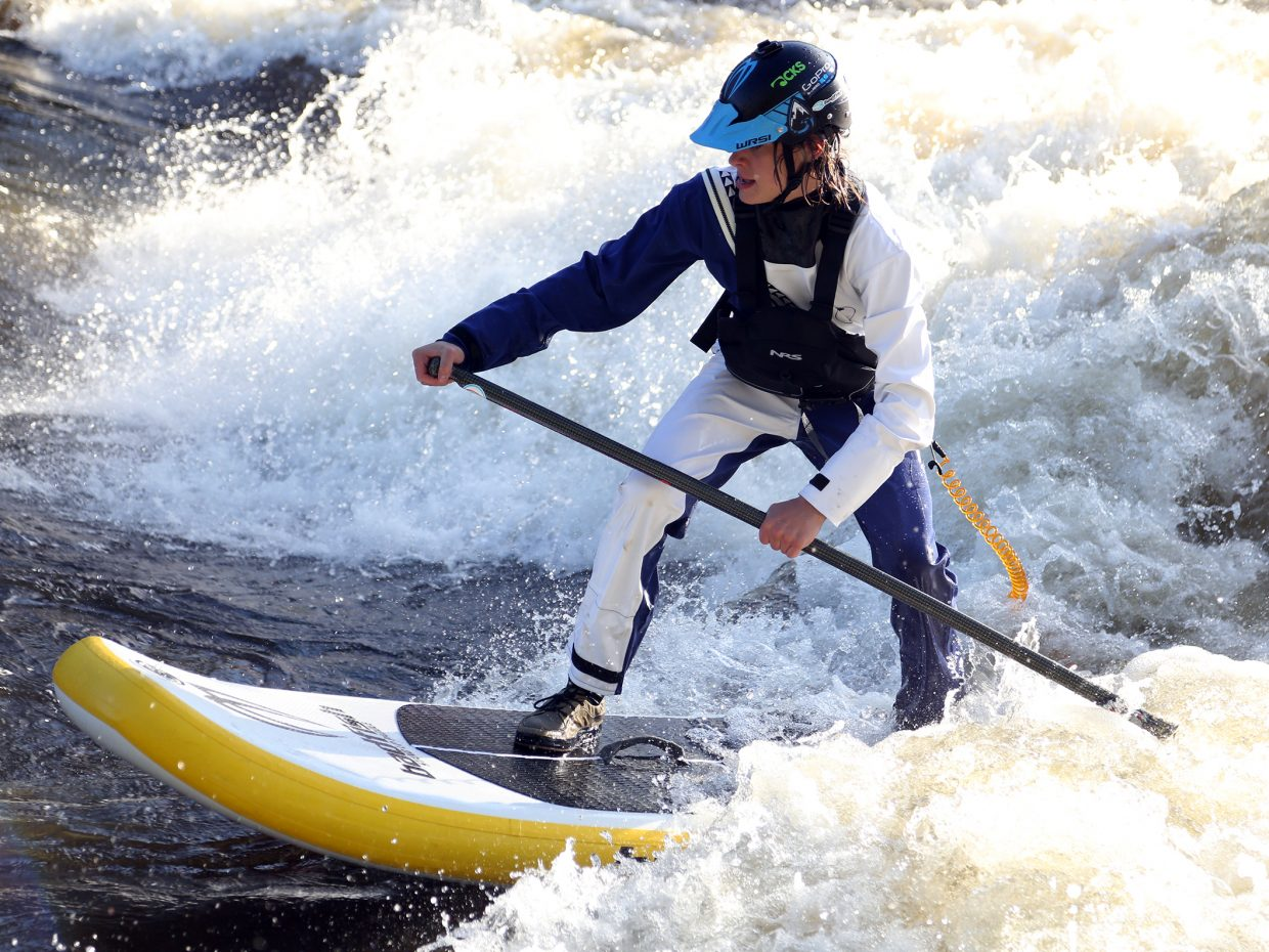 Bodhi Harrison attempts to surf Charlie's Hole during the 2015 Yampa River Festival in Steamboat Springs.