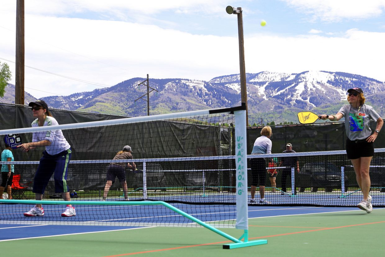 People gather at the Howelsen Park tennis courts Sunday in Steamboat Springs to play pickleball. The games were put on by the Steamboat Springs Pickleball Association. SSPA will hold its monthly beginners clinic from 5 to 6:30 p.m. Tuesday at the Tennis Center at Steamboat Springs. Cost is $10. For more information, visit sspa.club.