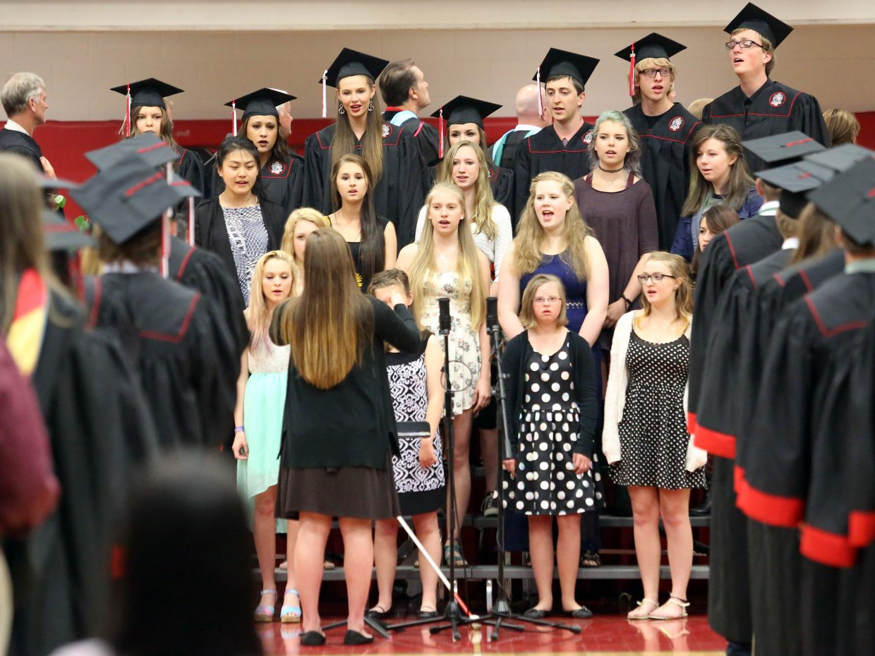 The SSHS choir, directed by Annie Lagier, sings the National Anthem prior to the start of the 2015 Steamboat Springs High School class graduation on Saturday, June 6, in the school gymnasium.