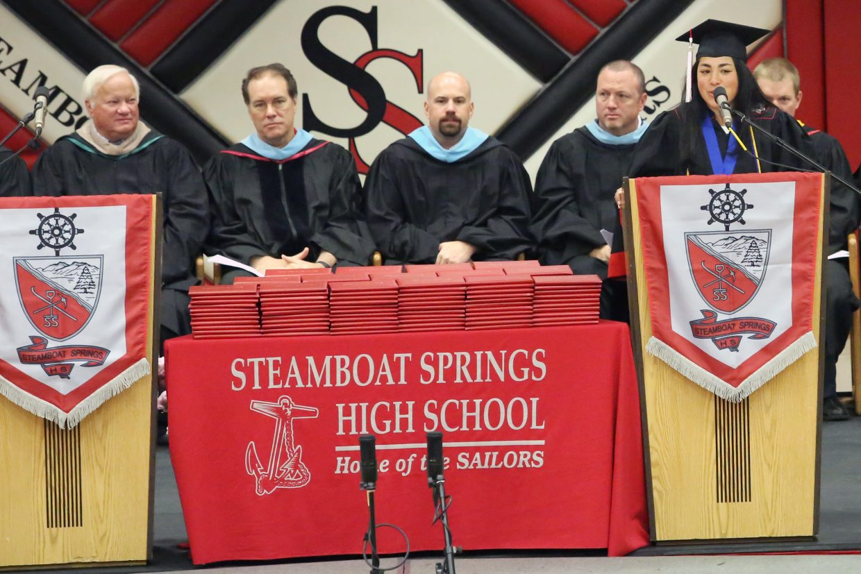 Steamboat Springs High School distinguished student speaker Norma Techarukpong talks to her classmates during the 2015 class graduation on Saturday, June 6, in the school gymnasium.