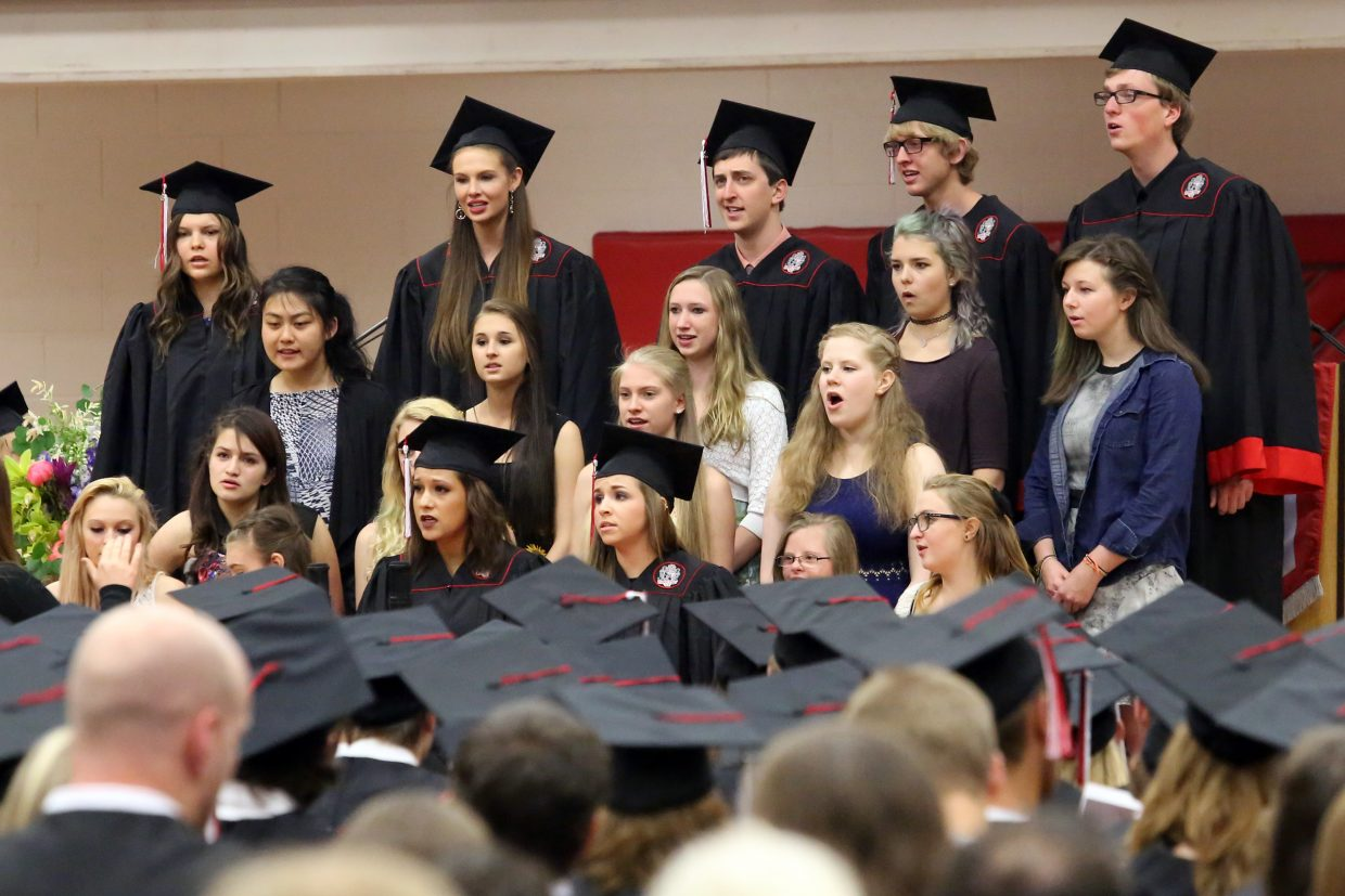 """The SSHS choir performs """"Finale B"""" during the 2015 Steamboat Springs High School class graduation on Saturday, June 6, in the school gymnasium."""