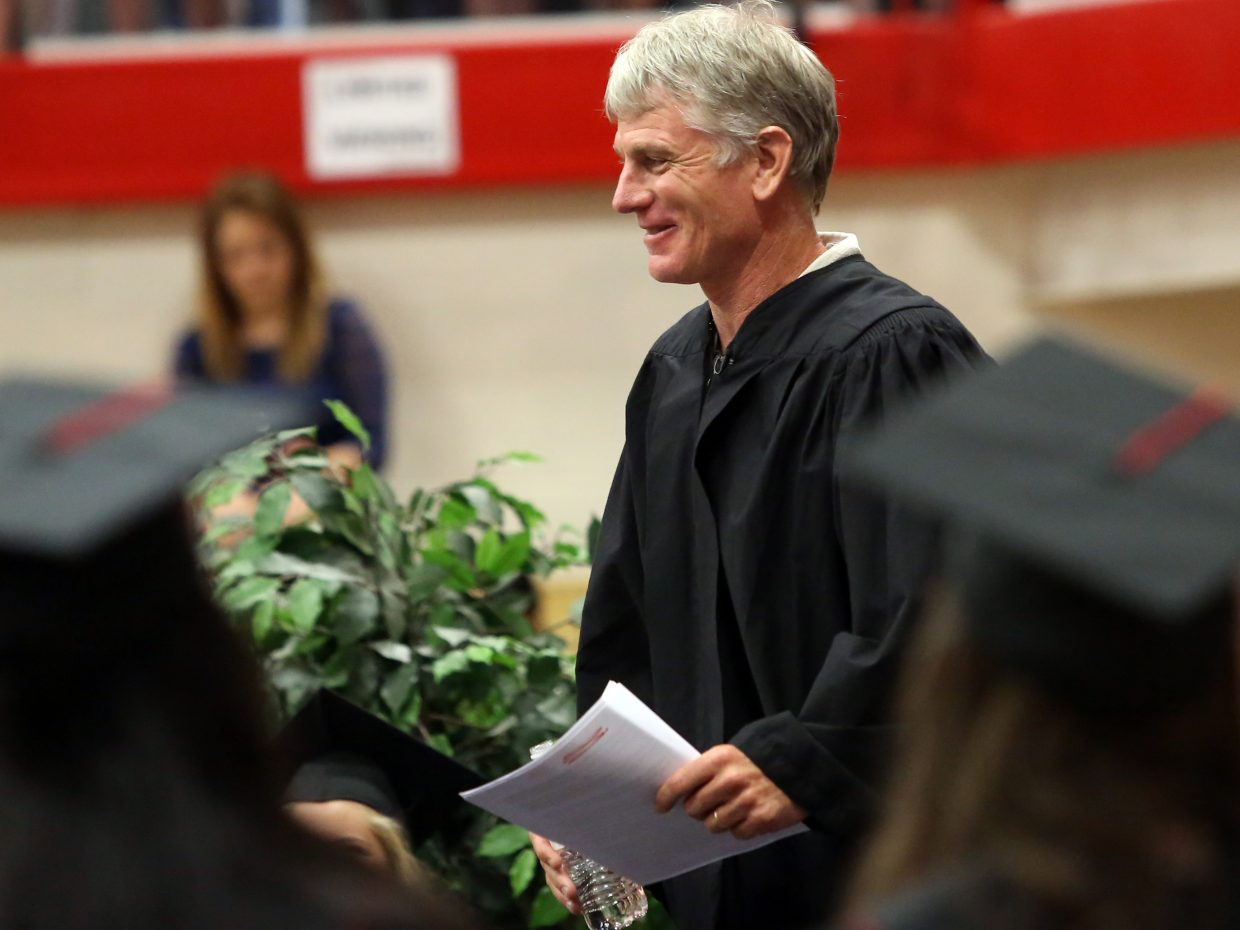 Honorary presenter Todd Musselman prepares to give his speech during the 2015 Steamboat Springs High School class graduation on Saturday, June 6, in the school gymnasium.