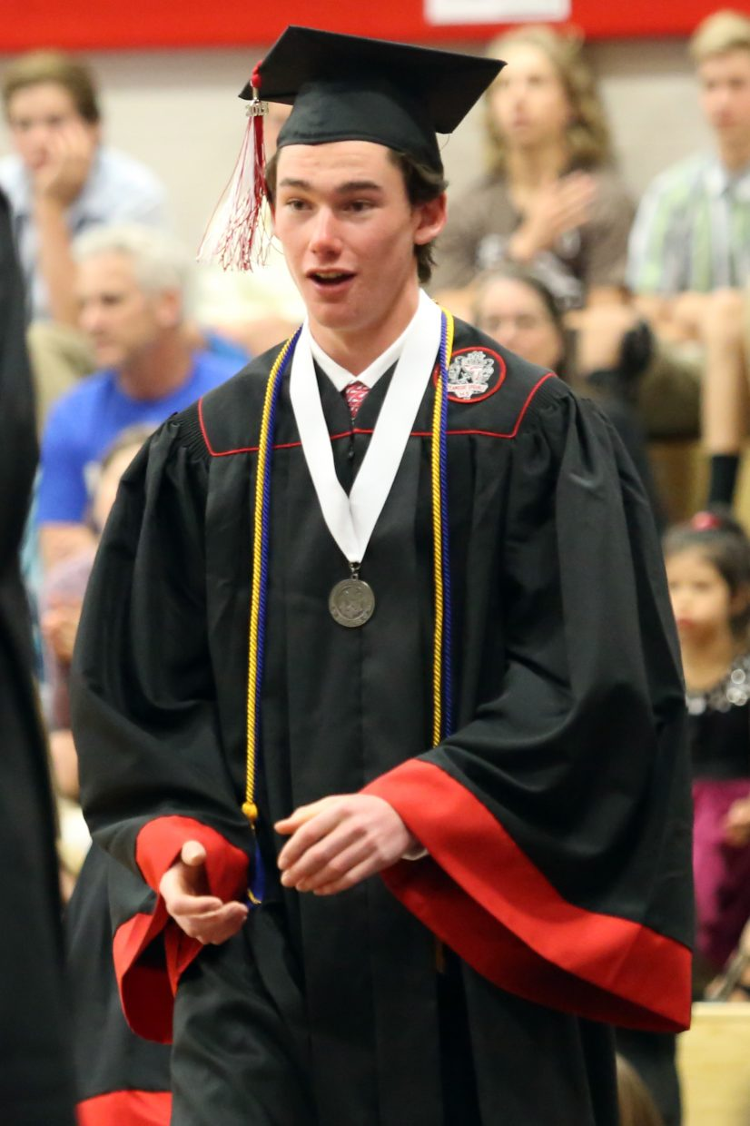 William Gunn walks across the stage prior to recieving his diploma during the 2015 Steamboat Springs High School class graduation on Saturday, June 6, in the school gymnasium.