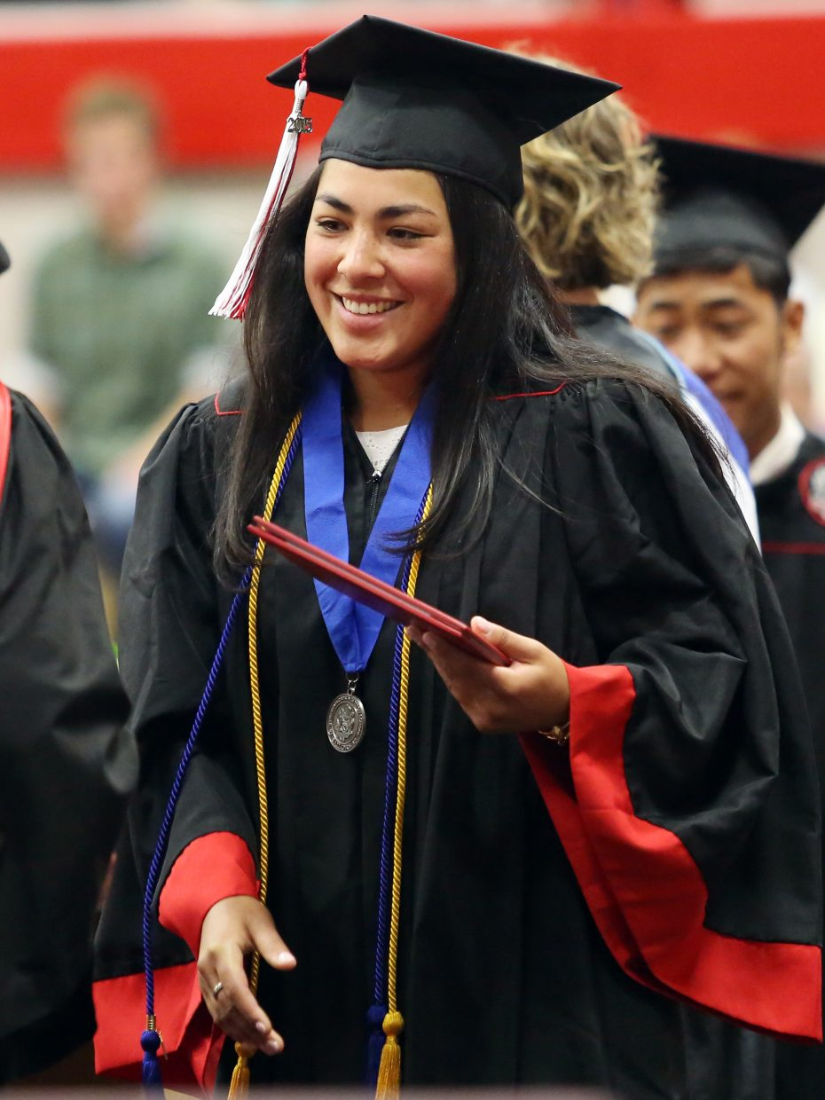 Norma Techarukpong walks across the stage and recieves her diploma during the 2015 Steamboat Springs High School class graduation on Saturday, June 6, in the school gymnasium.
