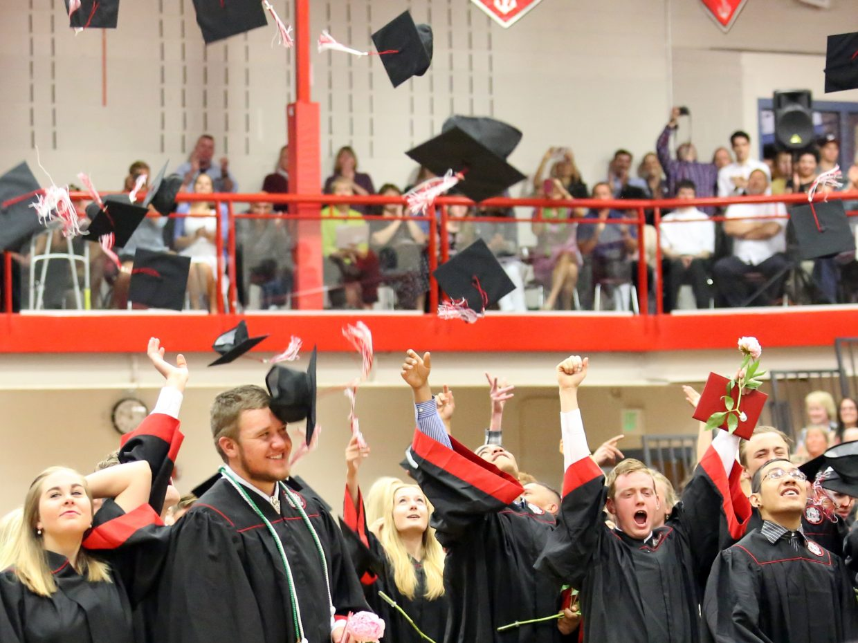 Students celebrate after officially being announced as graduates during the 2015 Steamboat Springs High School class graduation on Saturday, June 6, in the school gymnasium.