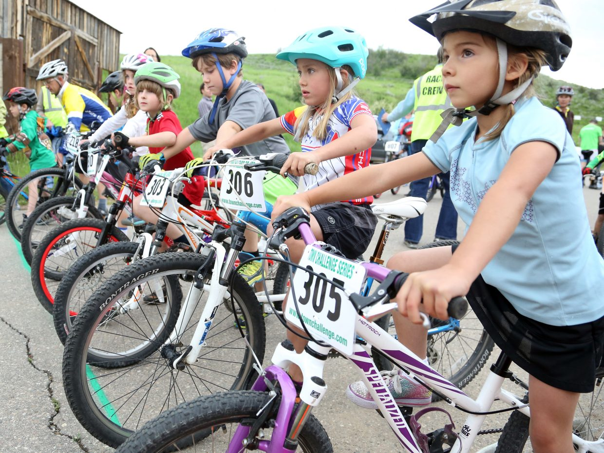Children get ready to compete in the youth coed 7 and 8 year old category in the Marabou XC Town Challenge race on Wednesday, June 10, 2015, at Marabou Ranch.