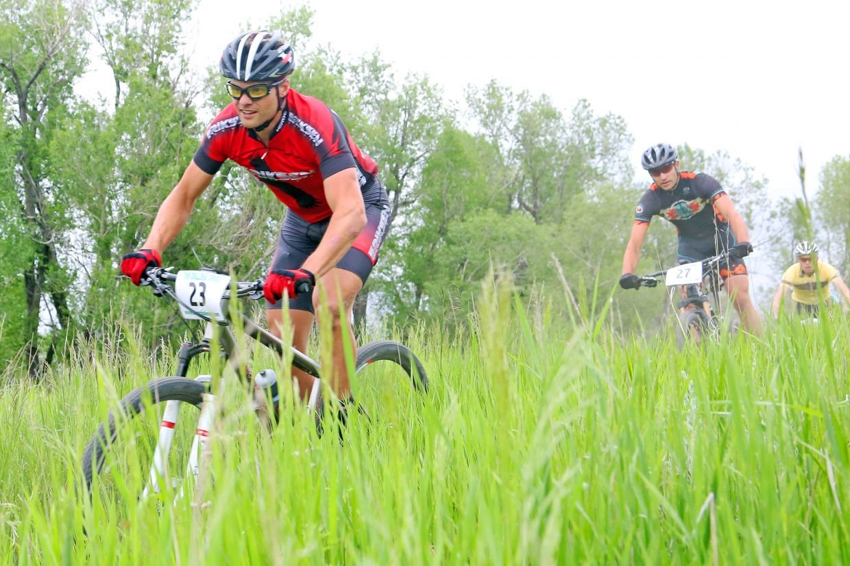 Brad Bingham of Steamboat Springs, left, competes in the men's pro/open division of the season's first Town Challenge race on Wednesday, June 10, 2015, at Marabou Ranch. Bingham won the race in 50 minutes, 44 seconds.