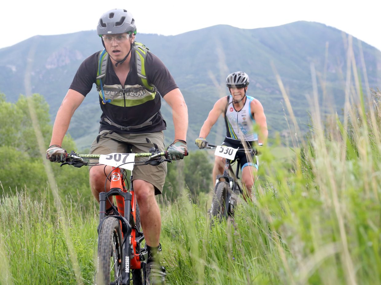 Donald Nyquist, left, and Eddie Rogers compete in the Marabou XC Town Challenge race on Wednesday, June 10, 2015, at Marabou Ranch.