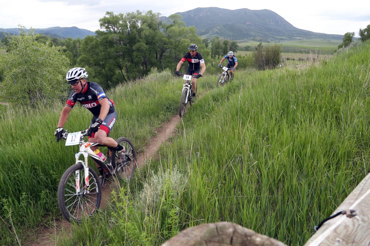 With the Sleeping Giant in the background, bikers compete in the Marabou XC Town Challenge race on Wednesday, June 10, 2015, at Marabou Ranch.