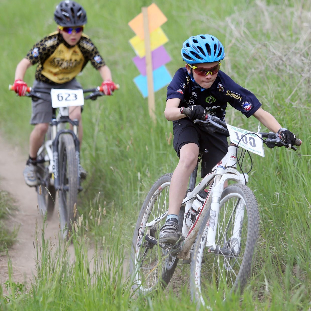 Chase High, front, and Bennett Gamber compete in the Marabou XC Town Challenge race on Wednesday, June 10, 2015, at Marabou Ranch.