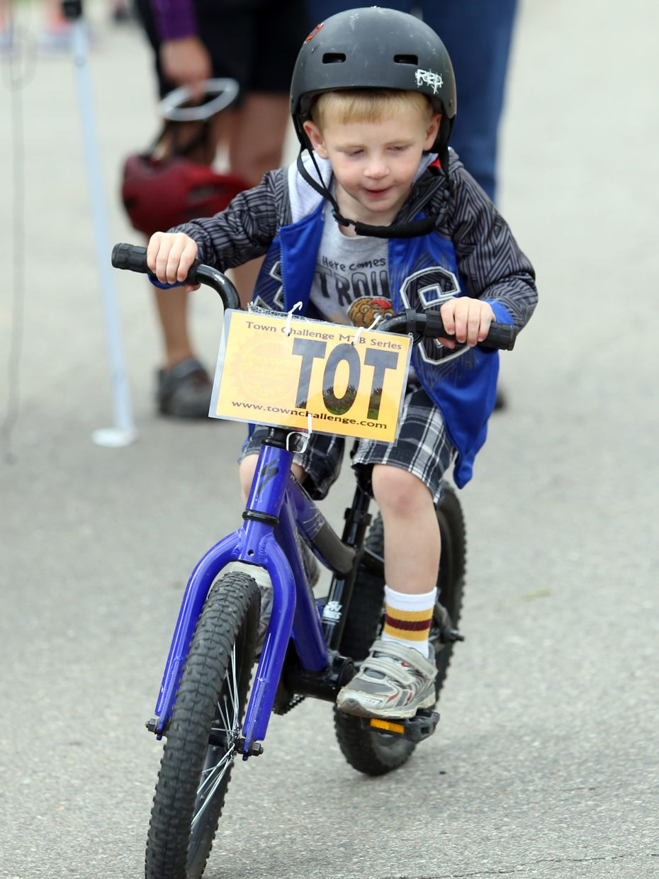 A young rider competes in the tot's division of the Marabou XC Town Challenge on Wednesday, June 10, 2015, at Marabou Ranch.