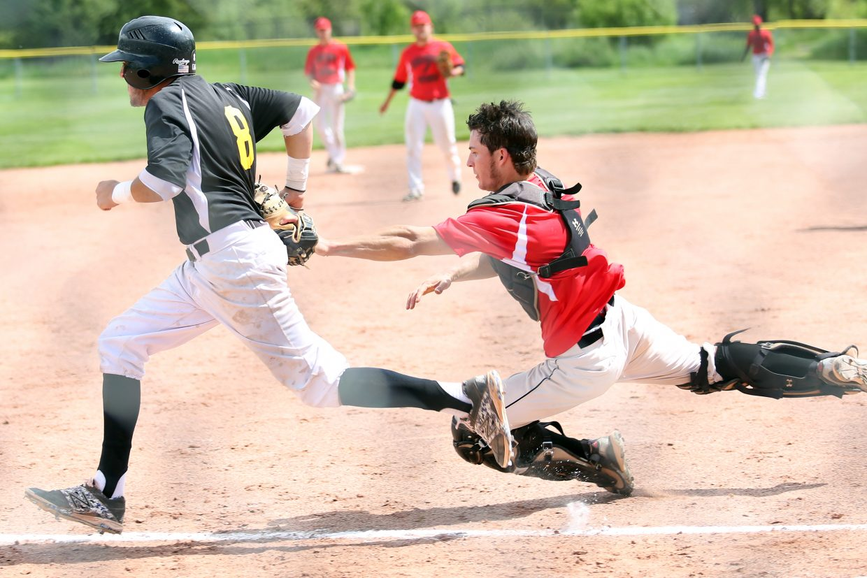 Steamboat Storm catcher Kyle Campbell tags Vail's Chase Venable for an out as he tries to return to third base in Game 2 on Saturday, June 13, 2015, at Emerald Park.