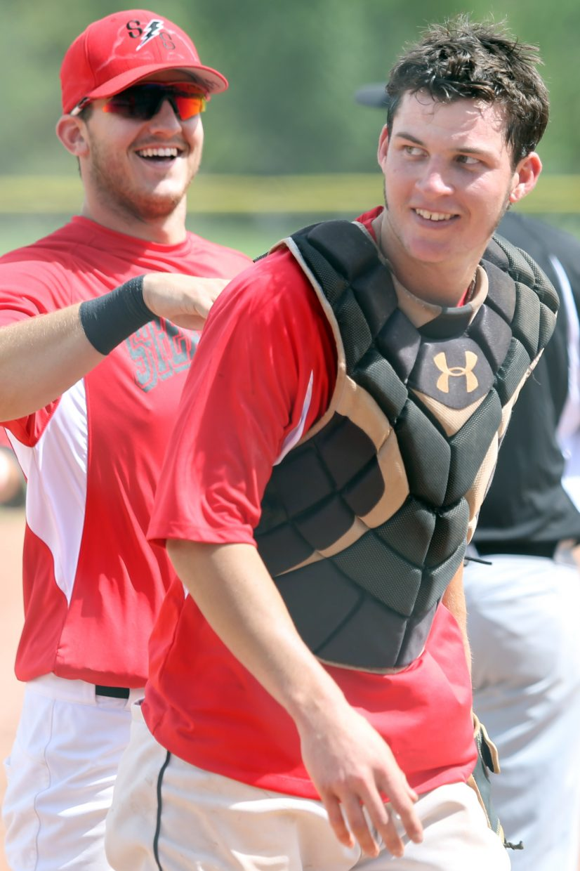 Steamboat Storm catcher Kyle Campbell, right, smiles after getting an out in Game 2 against Vail on Saturday at Emerald Park.