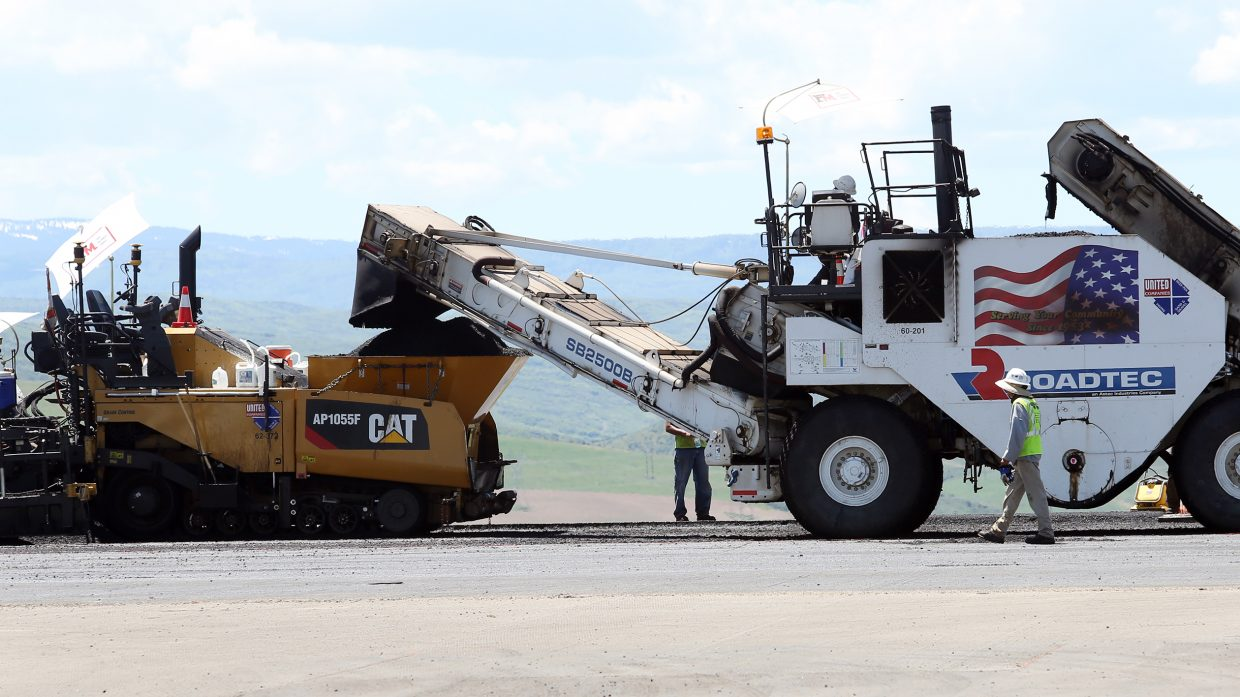 Construction workers continue to make progress on the Yampa Valley Regional airport runway by laying fresh asphalt on Sunday near Hayden. The airport celebrated its grand re-opening Sunday even though the actual operational opening has been pushed back to June 24.