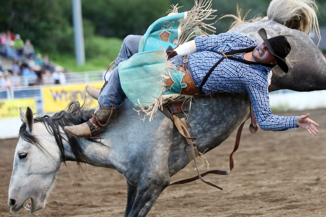 Jerad Schlegel, of Burns, competes in the bareback riding competition of Friday's season opening Steamboat Springs Pro Rodeo Series at Brent Romick Rodeo Arena in downtown Steamboat Springs.