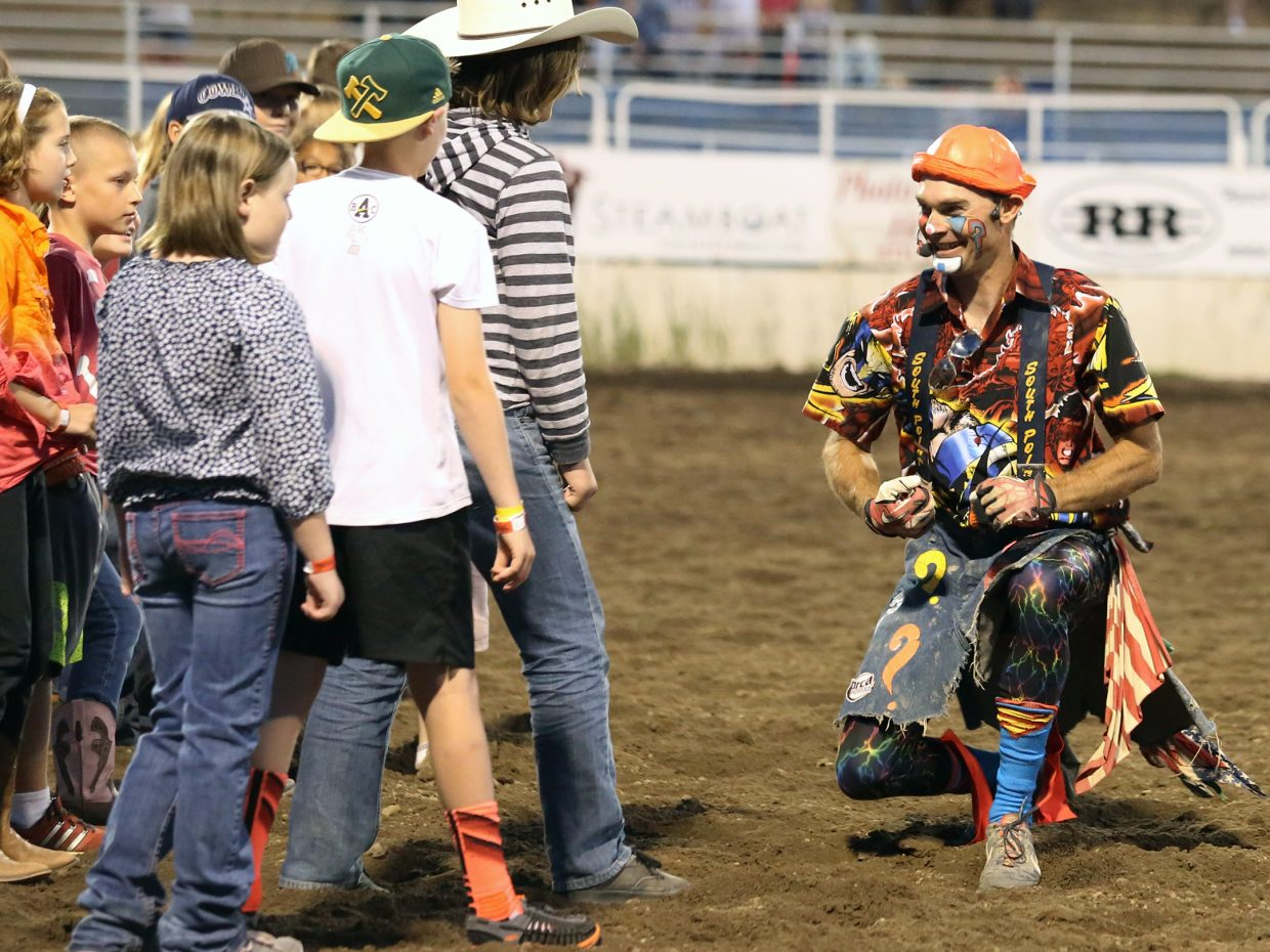 Rodeo clown J.W. Winklepleck, right, instructs children before a scramble during Friday's season opening Steamboat Springs Pro Rodeo Series at Brent Romick Rodeo Arena in downtown Steamboat Springs.