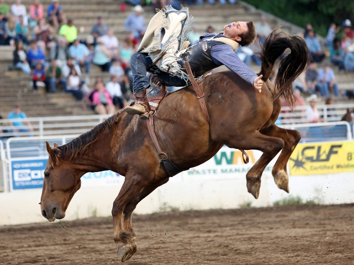 Colton Onyett, of Steamboat Springs, competes in the bareback riding competition of Friday's season opening Steamboat Springs Pro Rodeo Series at Brent Romick Rodeo Arena in downtown Steamboat.
