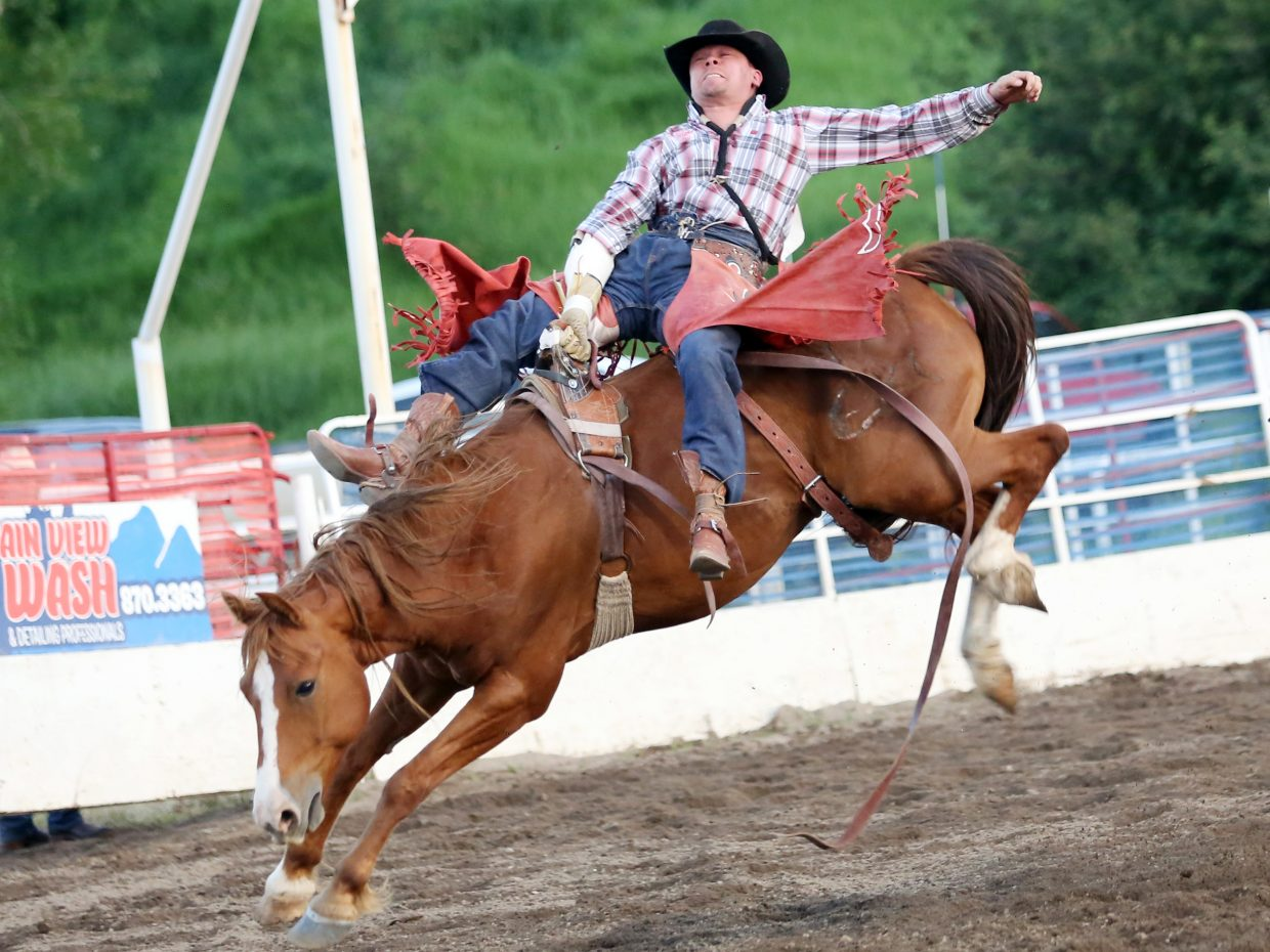 David Streweler, of Golden, competes in the bareback riding competition of Friday's season opening Steamboat Springs Pro Rodeo Series at Brent Romick Rodeo Arena in downtown Steamboat Springs.