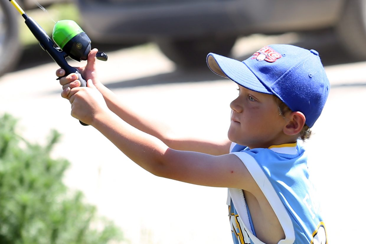 Part-time Steamboat Springs resident Connor Monahan, 7, casts his rod during Saturday's 33rd annual Fishing Derby, which was presented by the Steamboat Springs Optimist Club at Fetcher's Pond in Steamboat.