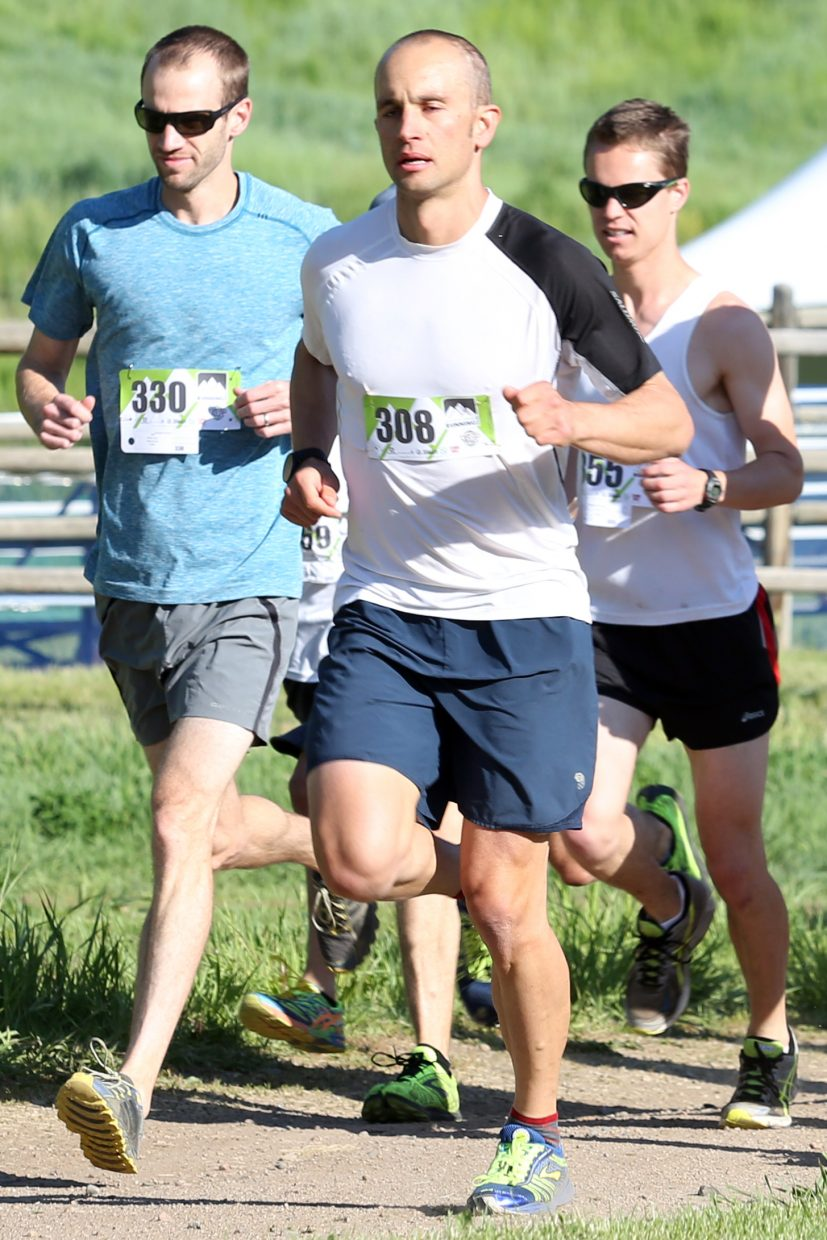 Longmont's Paul Moth, left, competes in Saturday's eight-mile race of the Howelsen Hill Trail Run on Emerald Mountain in Steamboat Springs. Moth won the race with a time of 52 minutes, 35 seconds.