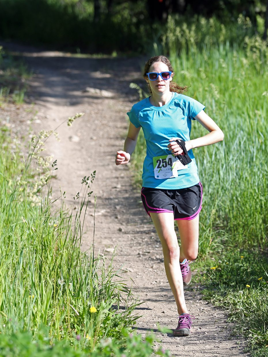 Elizabeth Hope competes in Saturday's four-mile race of the Howelsen Hill Trail Run on Emerald Mountain in Steamboat Springs. Hope was the top female finisher in the race with a time of 36 minutes, 46 seconds.