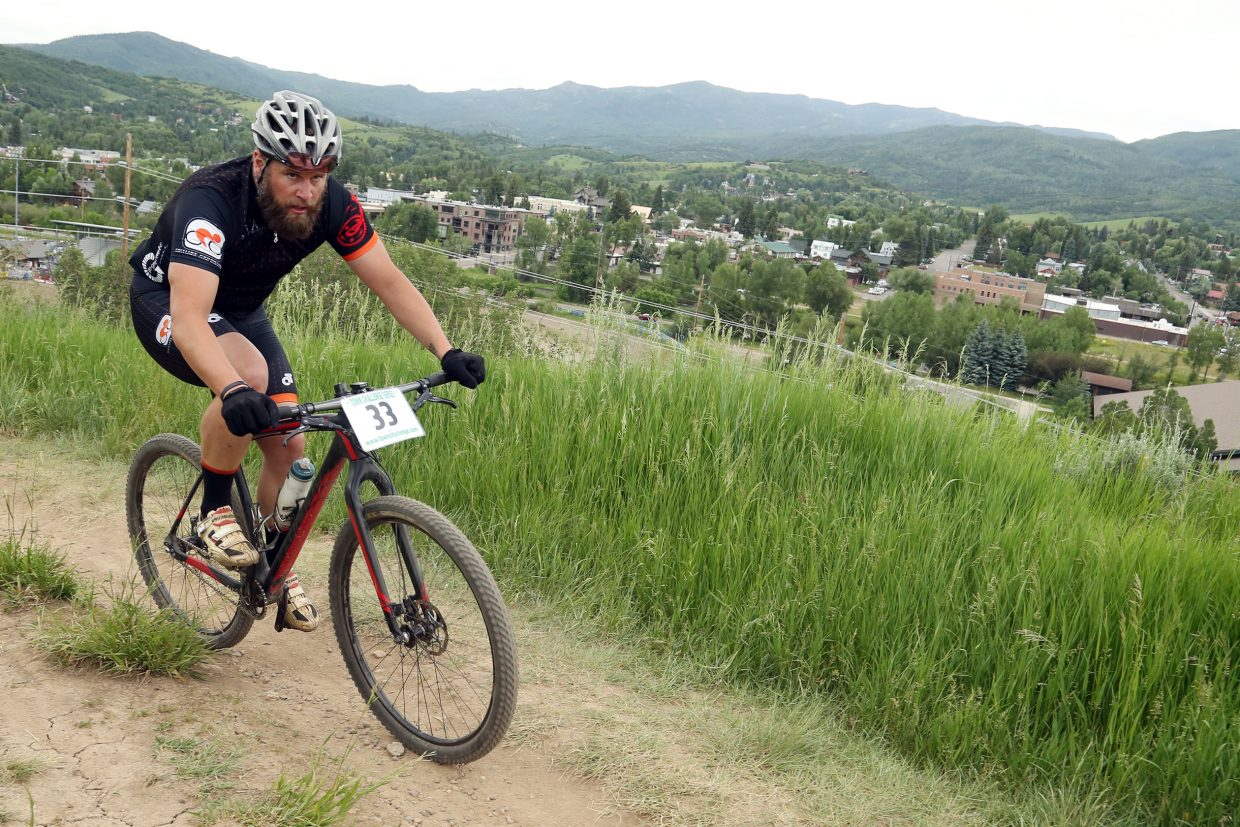 Brandon Lee competes in the men's single-speed division of the Emerald Envy XC Town Challenge mountain bike race on June 24 at Emerald Mountain in Steamboat Springs.