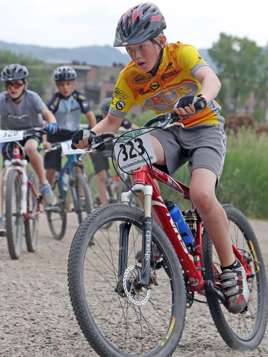 Daniel Kempers, right, competes in the youth male 11 to 12 division of the Emerald Envy XC Town Challenge mountain bike race on June 24, 2015, at Emerald Mountain in Steamboat Springs.